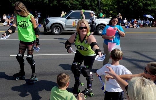Hard Knox Roller Girls hand out free admission to one of their events during Farragut's 24th Annual Independence Day Parade held Monday, Jul. 4, 2011 on Kingston Pike in Farragut.