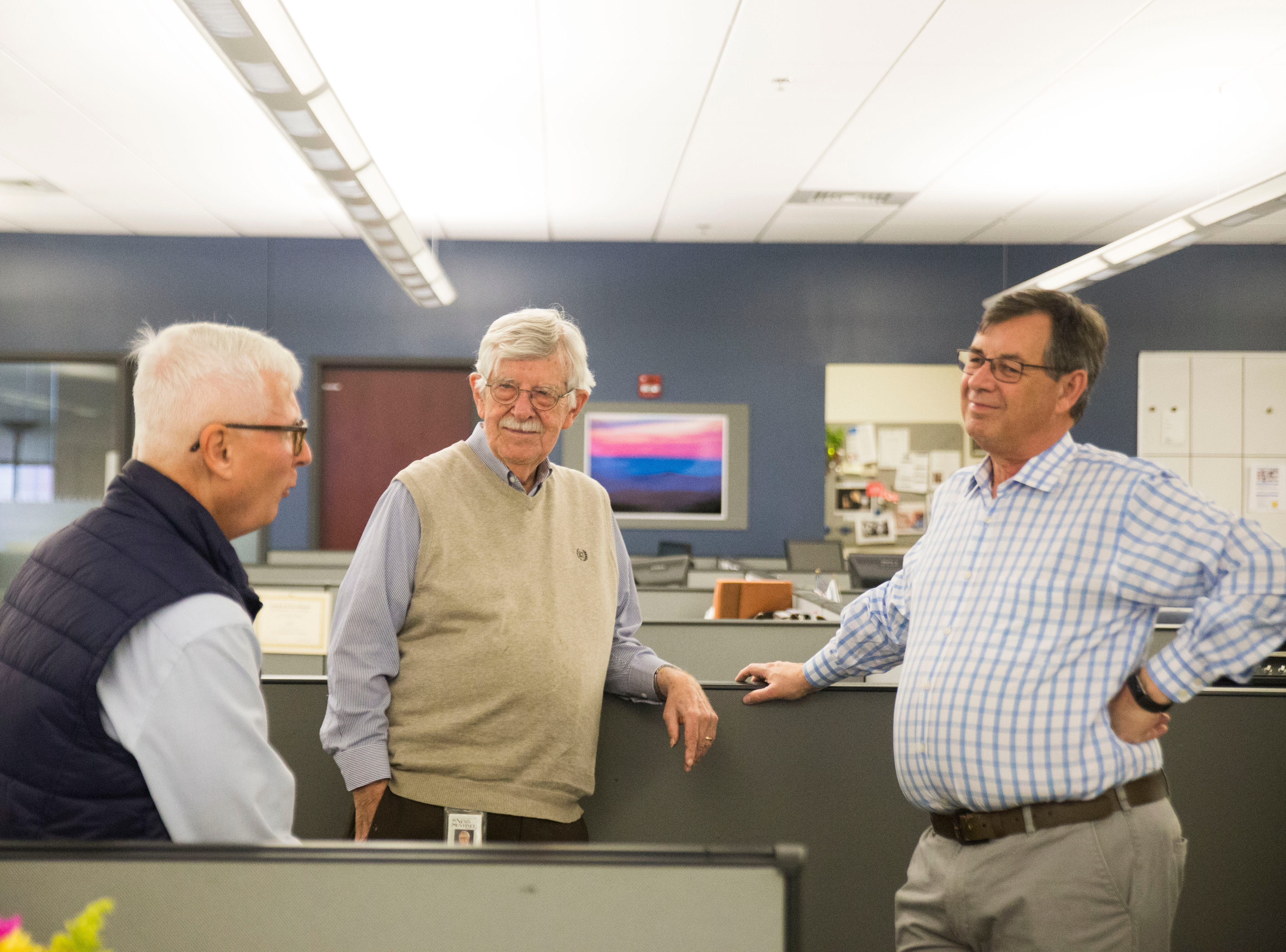 At right Jack Lail speaks with former colleague Frank Munger and current colleague Charlie Daniel as the newsroom celebrates the retirements of himself as well as Mary Constantine, Jack Lail and Michael Patrick on Wednesday, January 2, 2019.