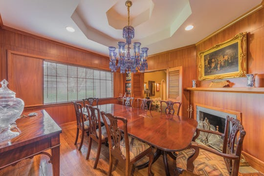 The formal dining room exudes old world charm.