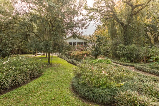 The gardens and property include almost two acres in the heart of Lafayette.