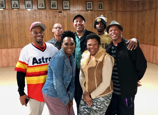 Earl Luckett (back center) stands with members of his biological family that he met for the first time the weekend before New Year's Day at a party in Duson, Louisiana.