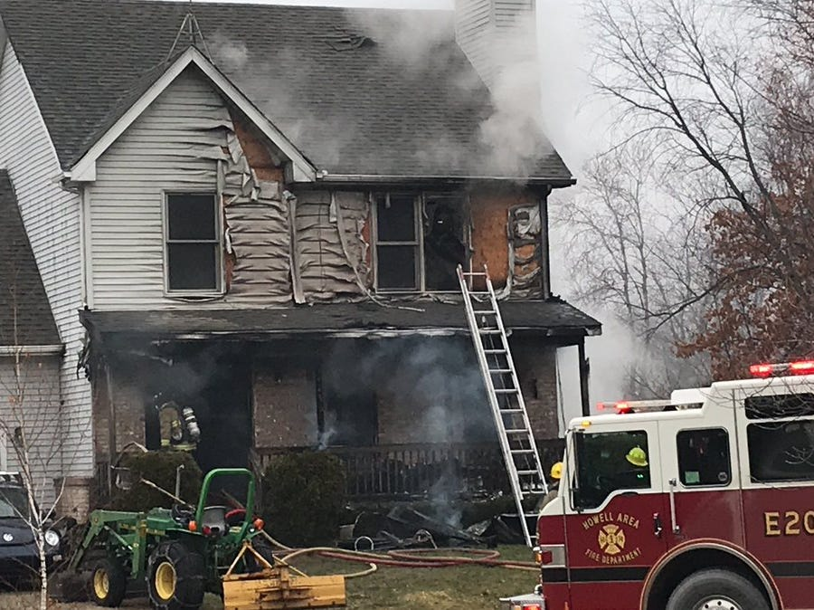 Firefighters battle a blaze in the 4200 block of Norton Road in Marion Township Wednesday, Jan. 2, 2019.