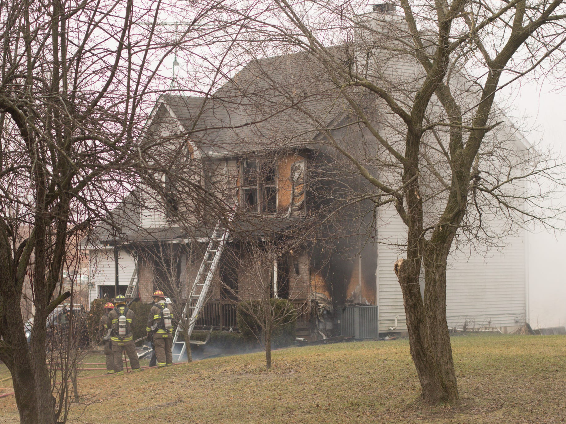Howell Area firefighters put out hot spots in a house fire on Norton Rd. in Marion Township Wednesday, Jan. 2, 2019.
