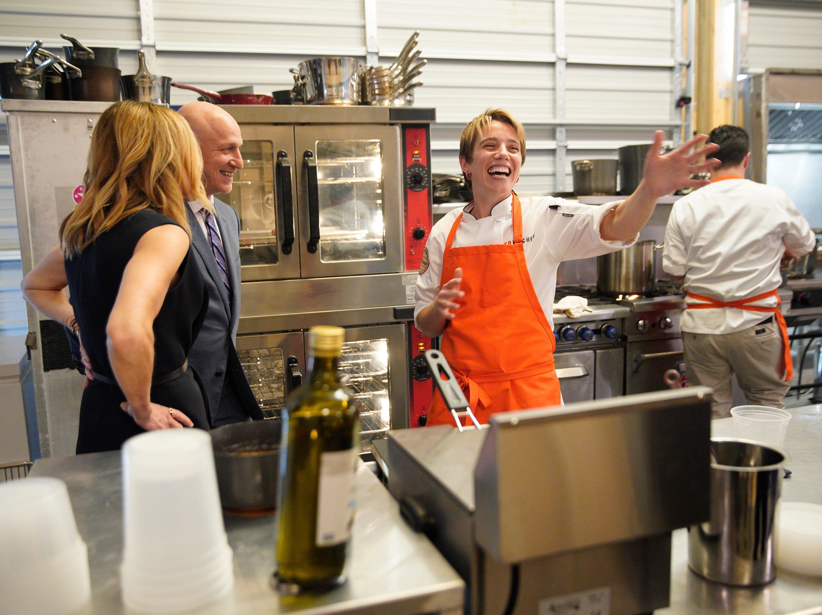 """(From left to right): Tom Colicchio talks to contestant Adrienne Wright on episode 5 of Bravo's """"Top Chef"""" Kentucky."""