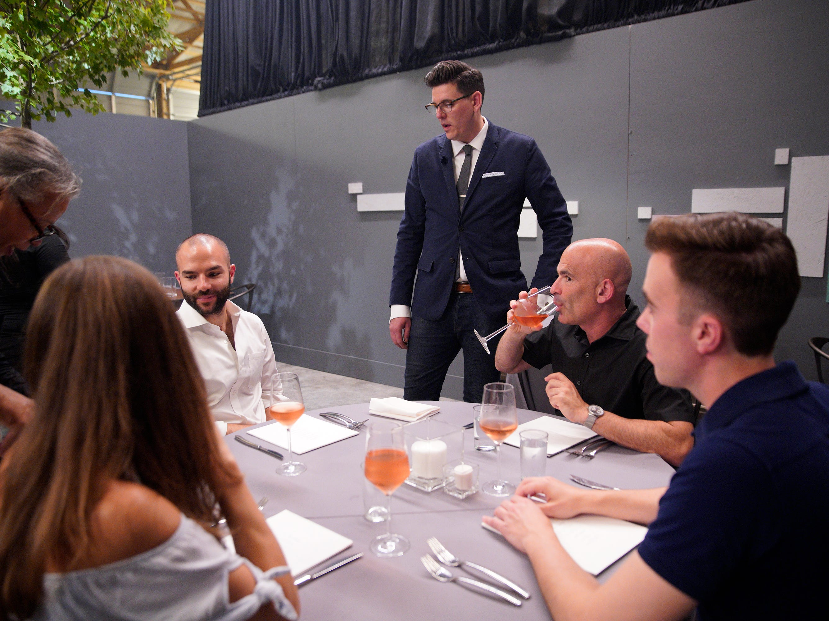 """Contestant Brian Young talks to a table of diners on episode 5 of Bravo's """"Top Chef"""" Kentucky."""