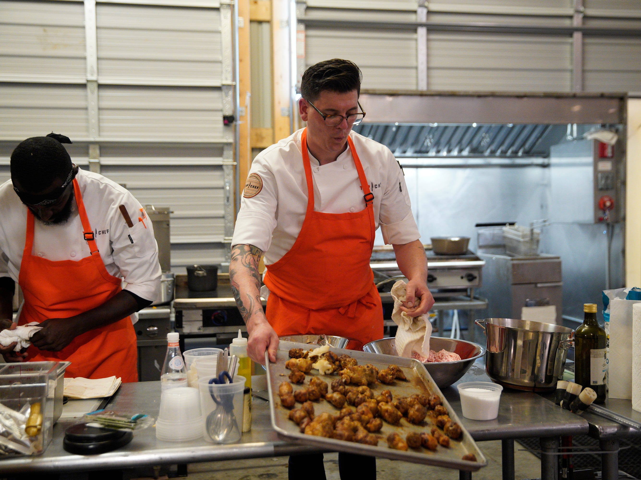 """(From left to right): Eric Adjepong and Brian Young on episode 5 of Bravo's """"Top Chef"""" Kentucky."""