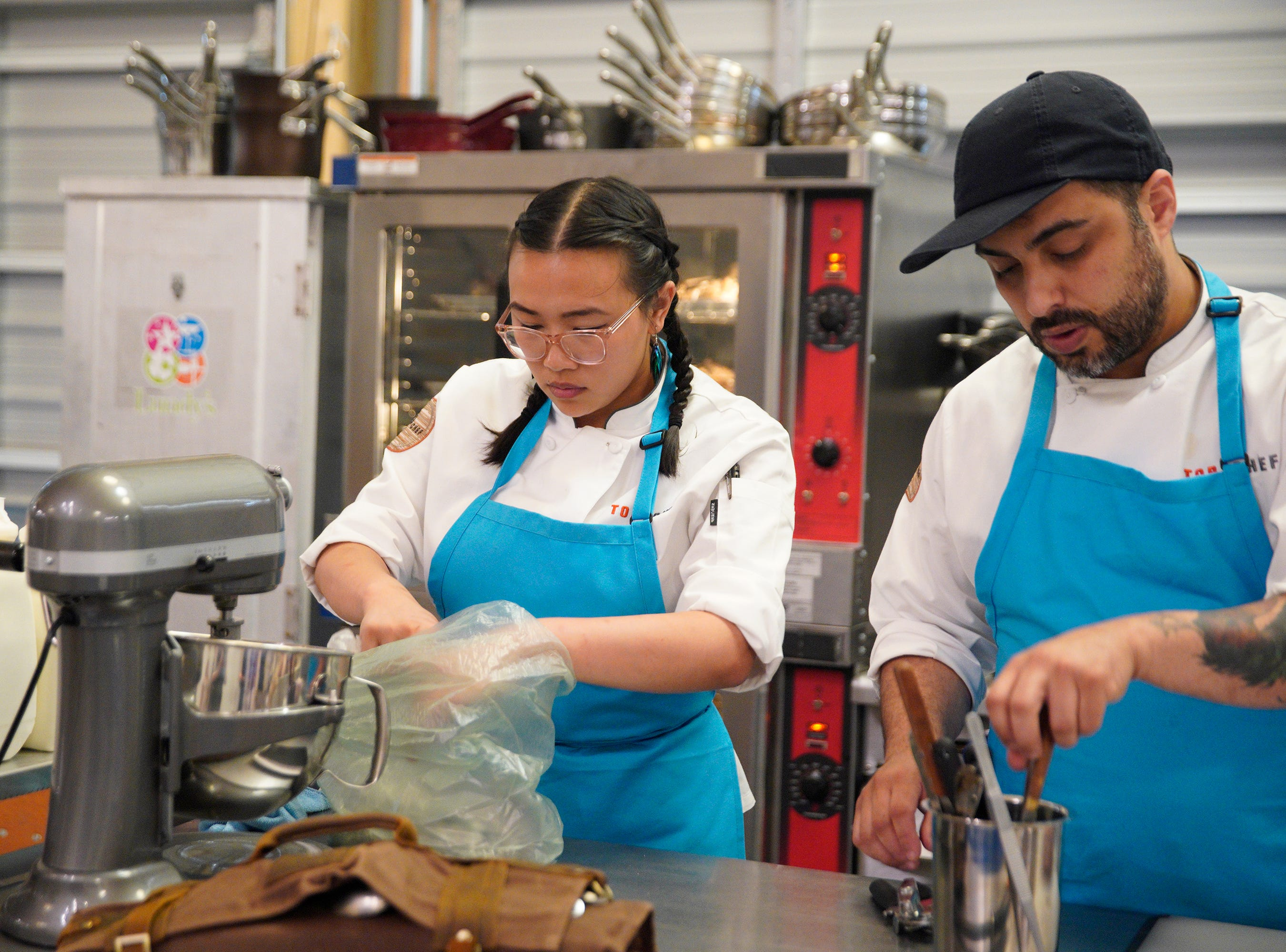 """(From left to right): Contestants Nini Nguyen and David Viana on episode 5 of Bravo's """"Top Chef"""" Kentucky."""