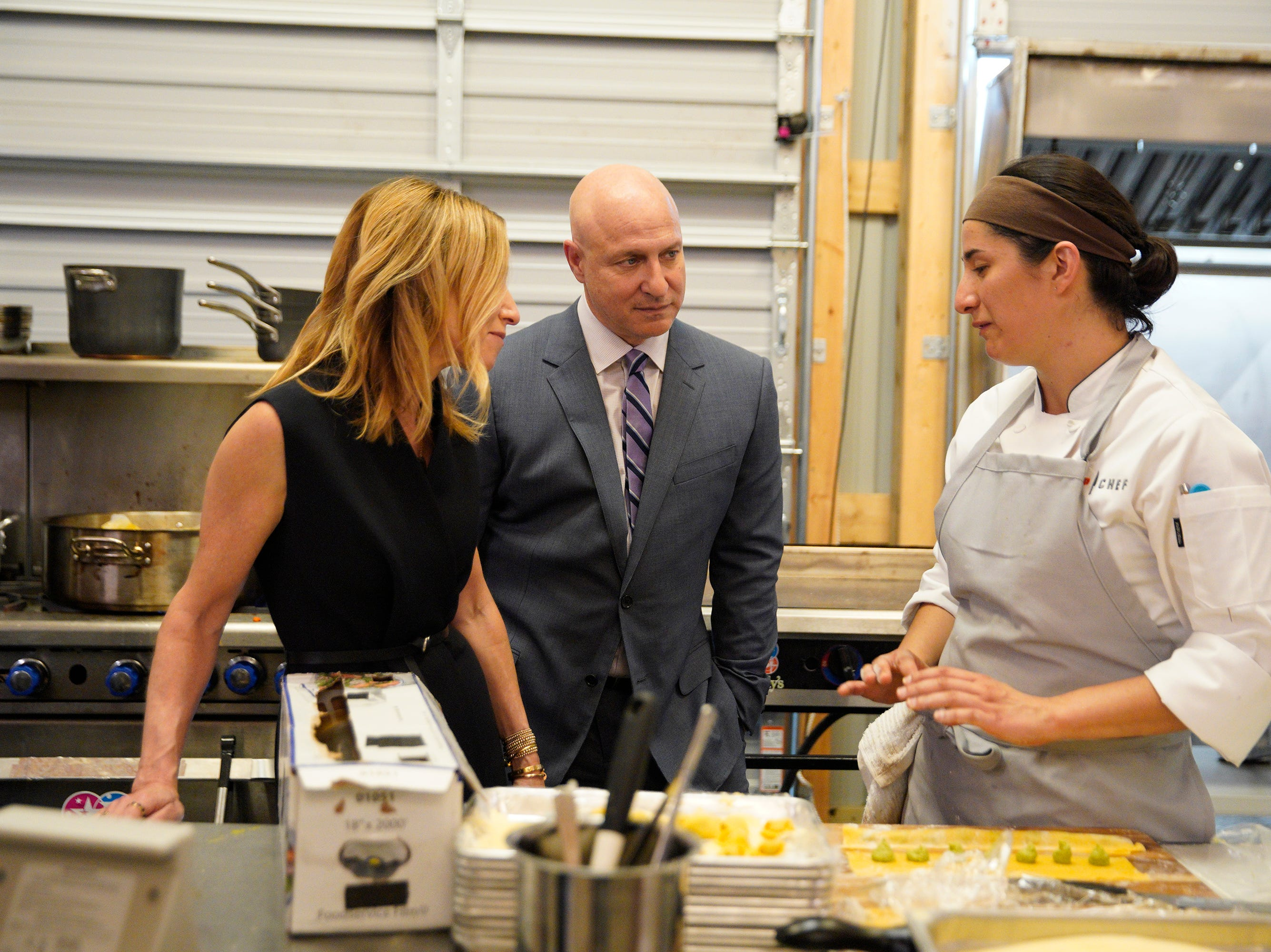 """(From left to right): Caroline Styne, Tom Colicchio and Michelle Minori on episode 5 of Bravo's """"Top Chef"""" Kentucky."""