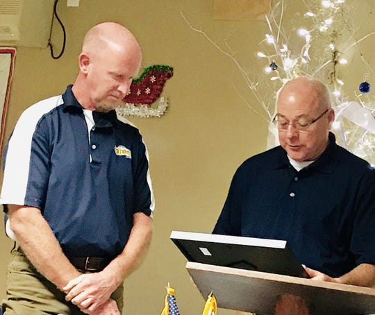 Manitowoc Lions Club presented John Brunner with its Distinguished Service Award. From left: Brunner and Al Kanugh, award committee chairman.