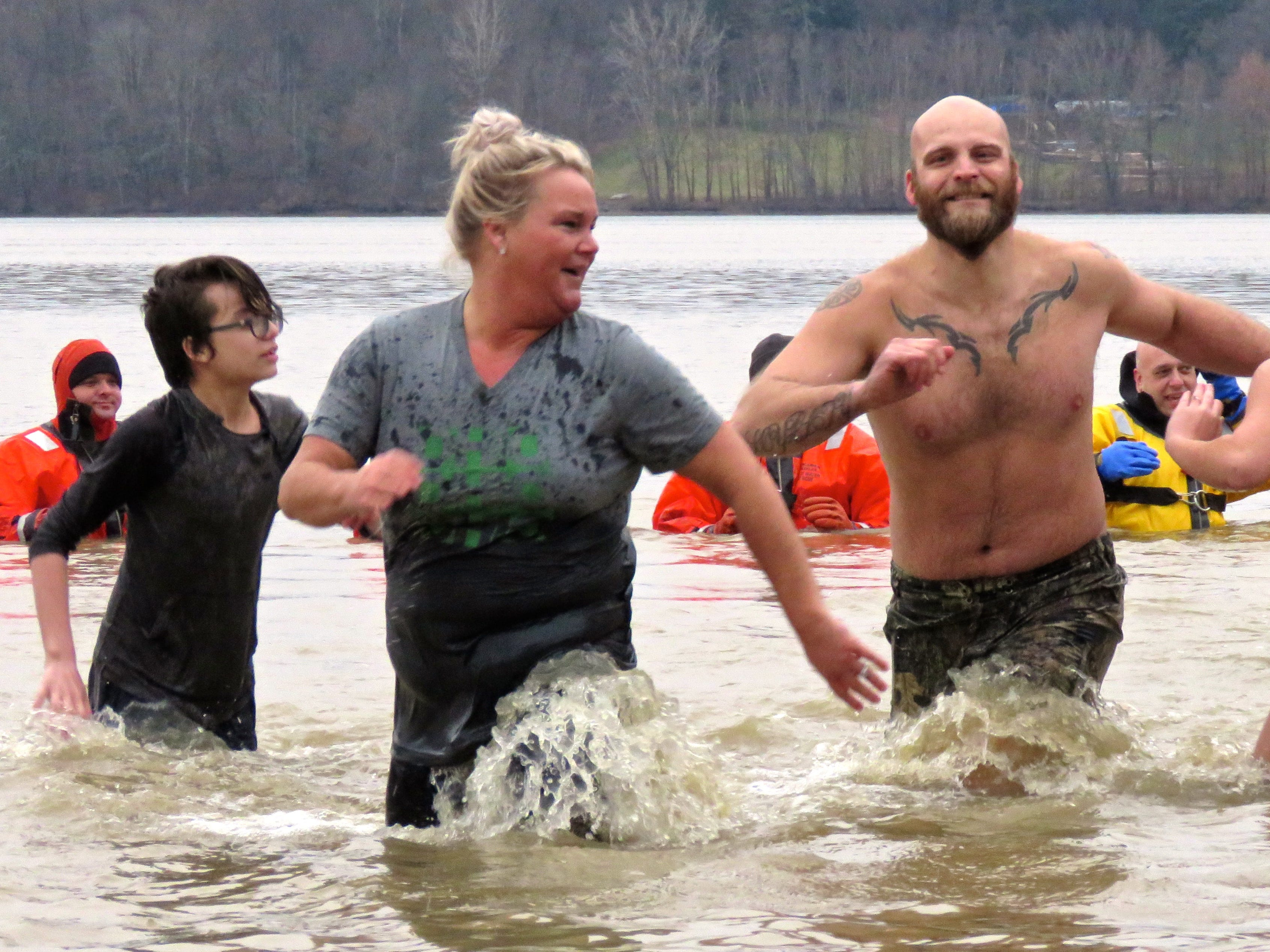 The 13th annual Polar Bear dip took place Tuesday at Charles Mill Lake.