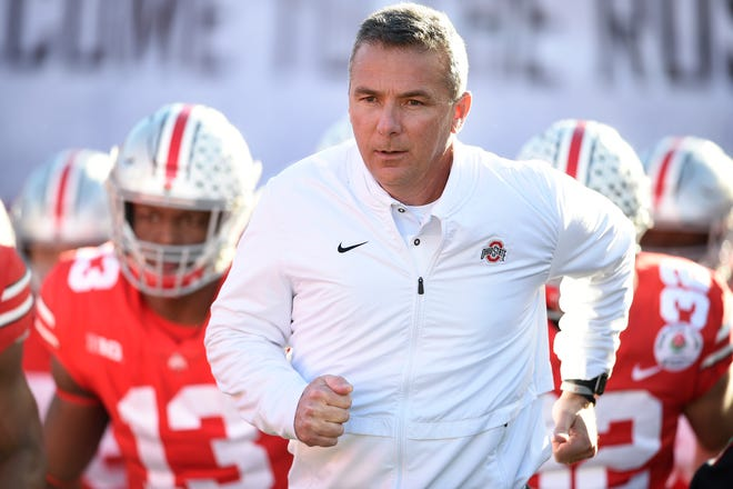 Urban Meyer leads the Ohio State Buckeyes onto the field at the Rose Bowl in his final game as head coach.