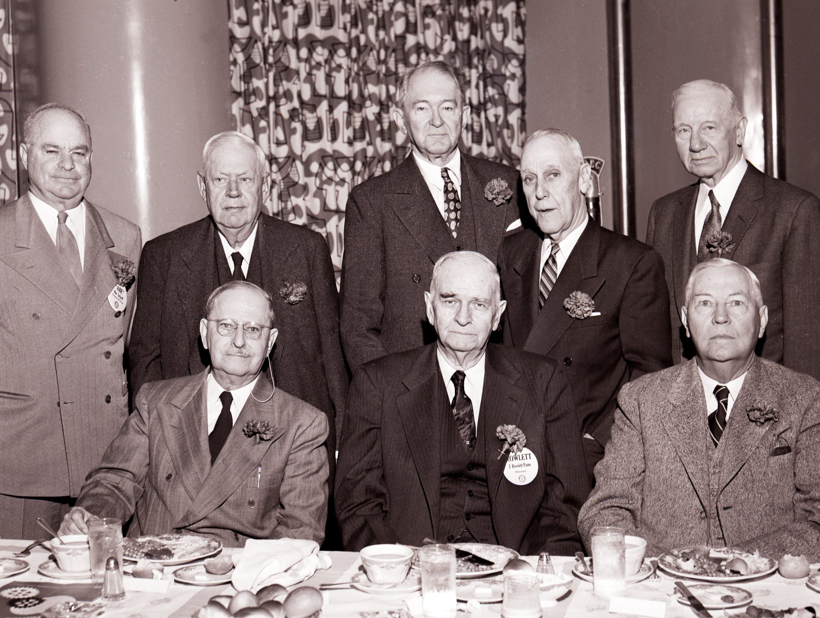 Seven charter members, and a member with a 34-year record of perfect attendance, were honored the first week of February 1955 as the Rotary Club observed its 41st birthday.  Charter members are (Seated from Left) E.R. Livermore, Rowlett Paine and W.R. King.  (Standing from Left) Abe Scharff, Frank Flournoy (the man who always attends the meetings), John W. McClure, Robert Metcalf and Fred Boehme.