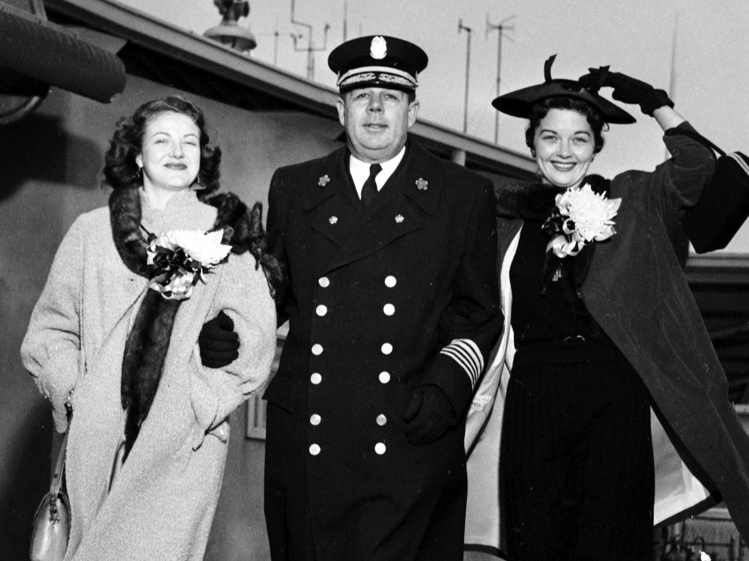 Memphis Fire Chief John C. Klinck performed the pleasant task in January 1956 of escorting two pretty young Memphians to a New Orleans-bound airplane at the Airport.  Miss Billie Loe (Left), Miss Flame, and Miss Anita Glaze, Miss Fire Prevention, won the trip when they were selected to the titles during Fire Prevention Week in 1955.