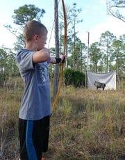 James Olsen doing archery.