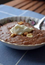 Nutty Chocolate Oatmeal can be topped with various extras, including peanuts and yogurt.