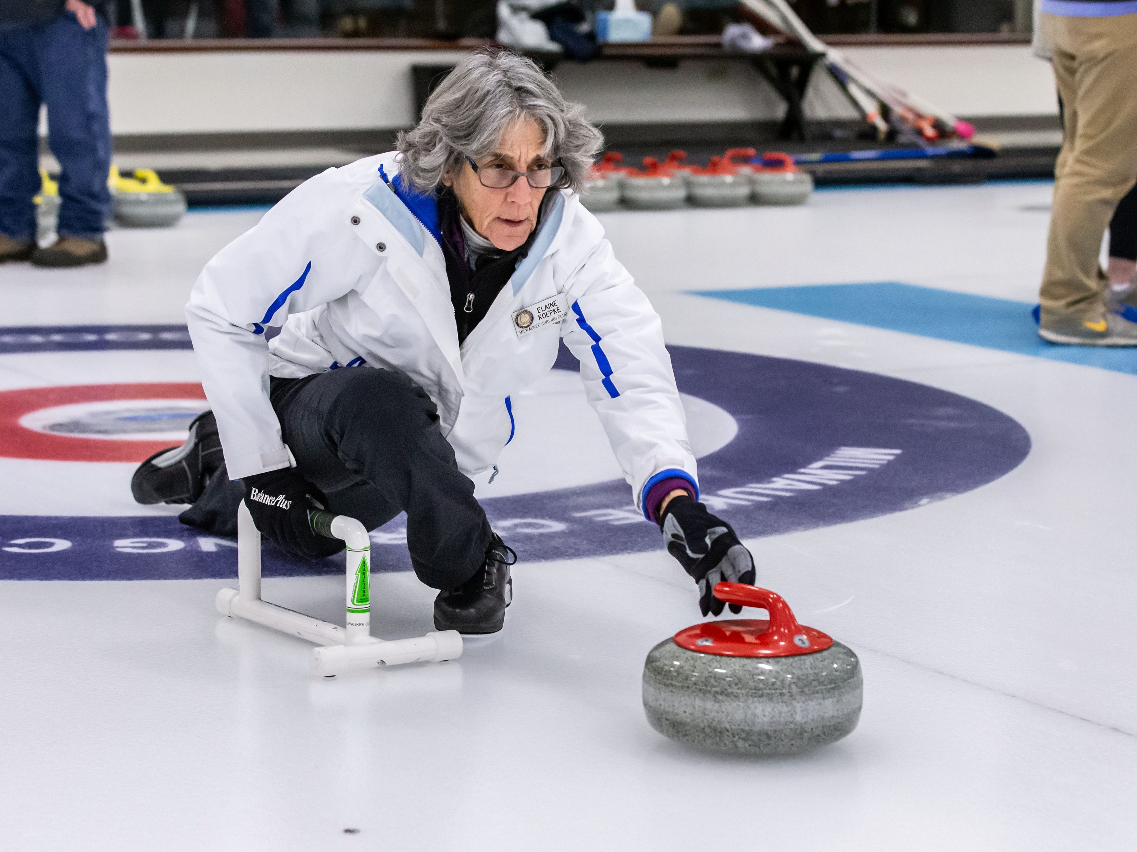 Curling instructors Elaine Koepke demonstrates releasing a stone during the Learn to Curl program at the Milwaukee Curling Club in Cedarburg on Saturday, Dec. 29, 2018.
