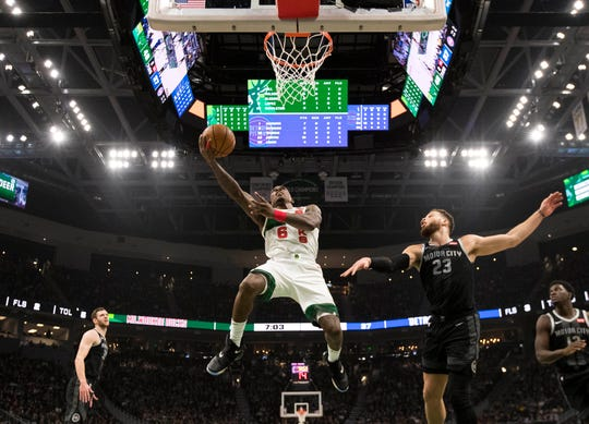 Bucks guard Eric Bledsoe shoots during the second quarter against the Detroit Pistons. Bledsoe had 18 points and six assists Tuesday.