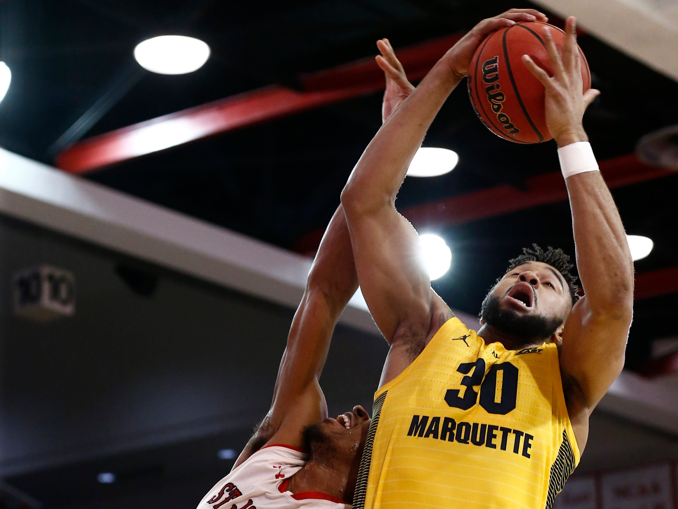 Jan 1, 2019; Queens, NY, USA; St. John's Red Storm guard Justin Simon (5) fights for the ball against Marquette Golden Eagles forward Ed Morrow (30) in the first half at Carnesecca Arena. Mandatory Credit: Nicole Sweet-USA TODAY Sports