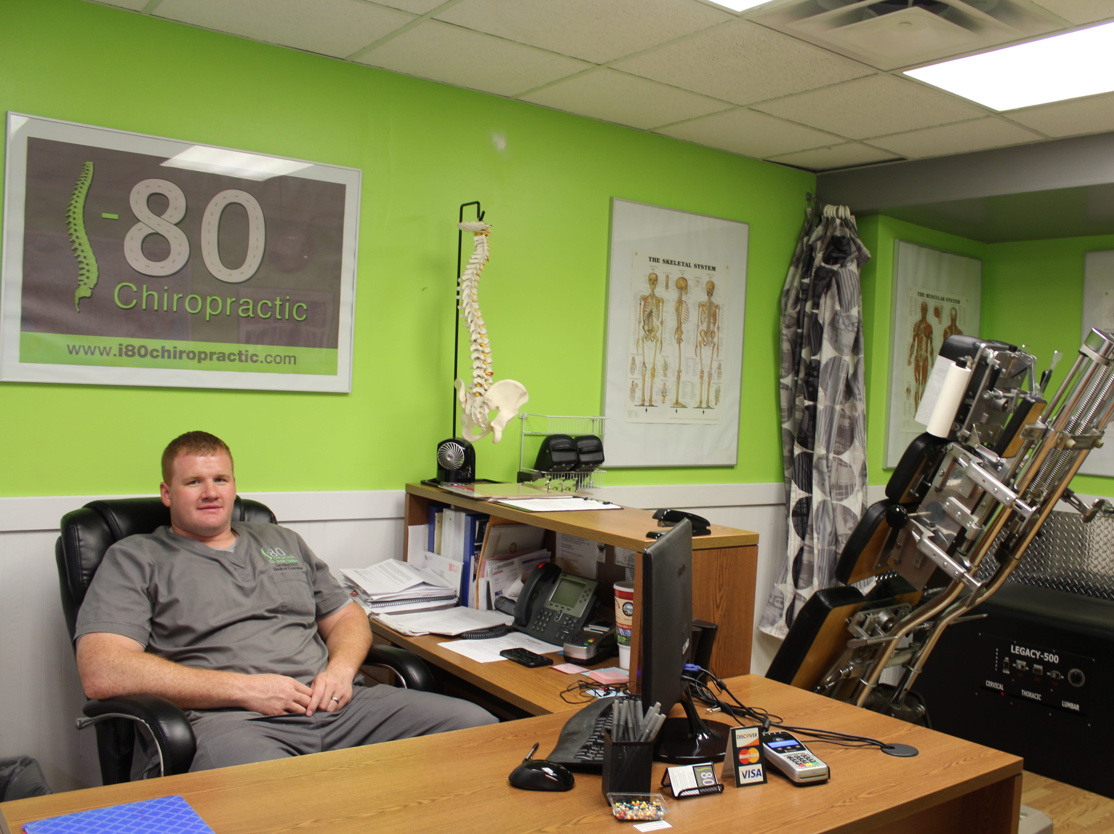 Chiropractor Justin Seifert takes walk-ins at his office in the Iowa 80 truck stop.