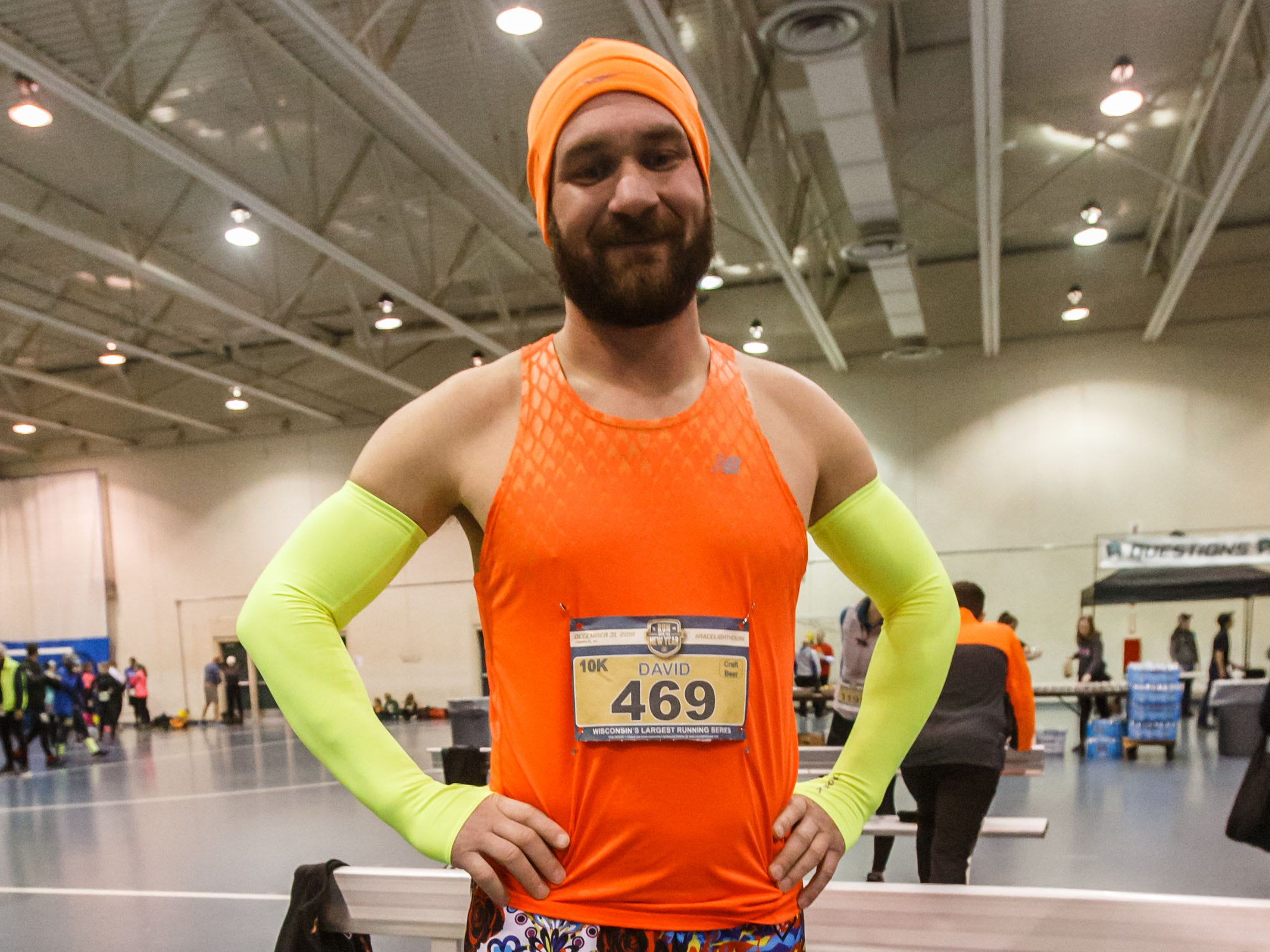 Dave Markle of Madison shows off a splash of color prior to the 14th annual Run Into the New Year hosted by Lighthouse Events at the Milwaukee County Sports Complex in Franklin on Monday, Dec. 31, 2018.