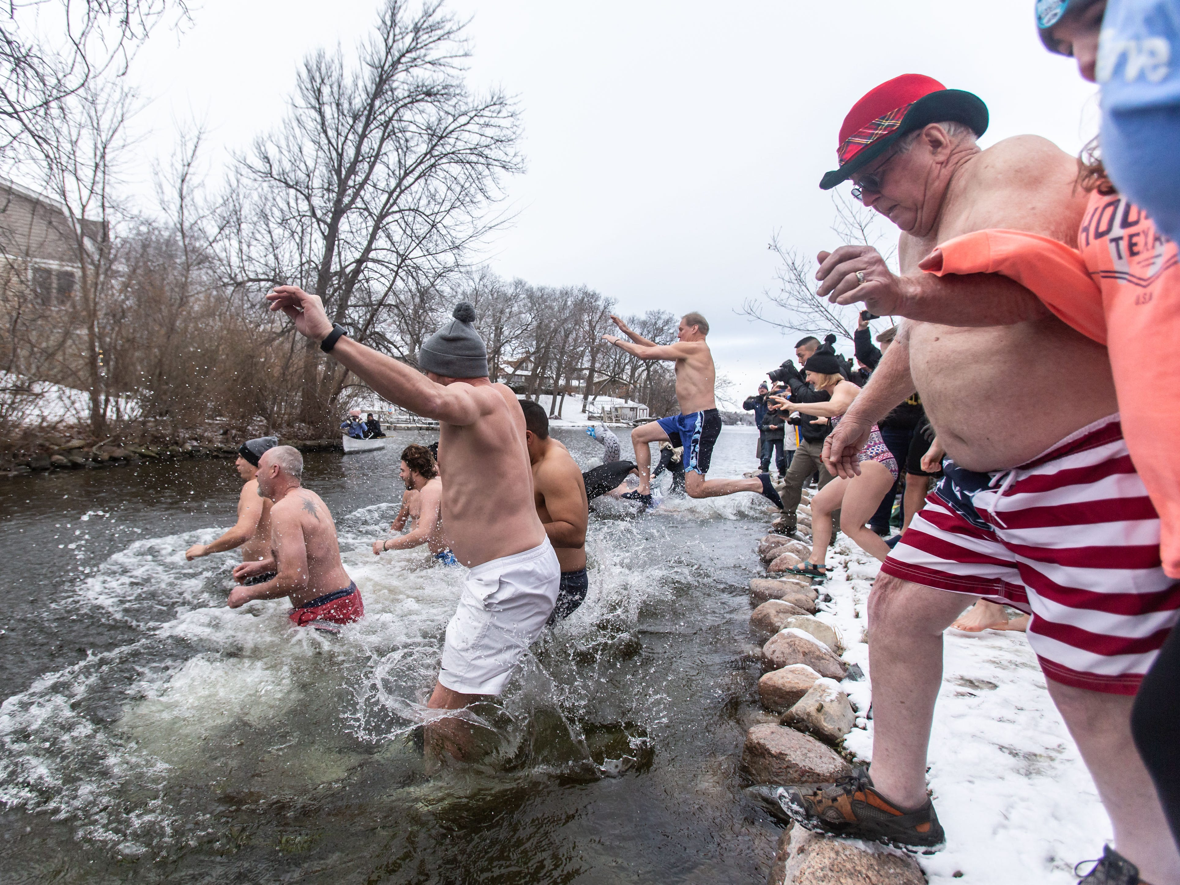 Eighty-year-old James Wirth (right) of Sullivan participates in the annual Polar Plunge at Panga Bar & Grill in Oconomowoc on Tuesday, Jan. 1, 2019. Funds raised from this year's plunge will benefit research efforts of the Alzheimer's Association.