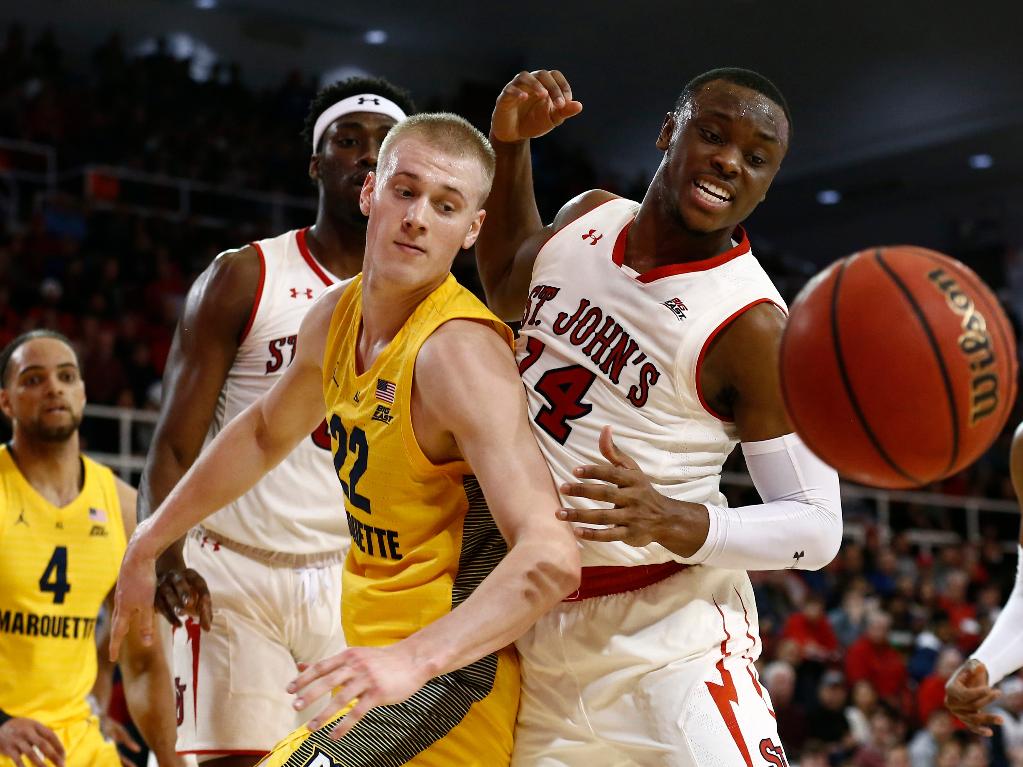 Jan 1, 2019; Queens, NY, USA; St. John's Red Storm guard Mustapha Heron (14) fights for possession of the ball against Marquette Golden Eagles forward Joey Hauser (22) in the first half at Carnesecca Arena. Mandatory Credit: Nicole Sweet-USA TODAY Sports