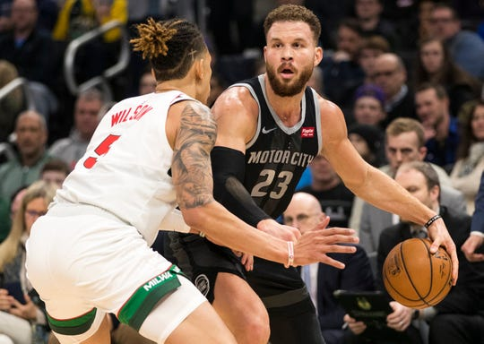 Jan 1, 2019; Milwaukee, WI, USA; Detroit Pistons forward Blake Griffin (23) dribbles the ball against Milwaukee Bucks forward D.J. Wilson (5) during the third quarter.