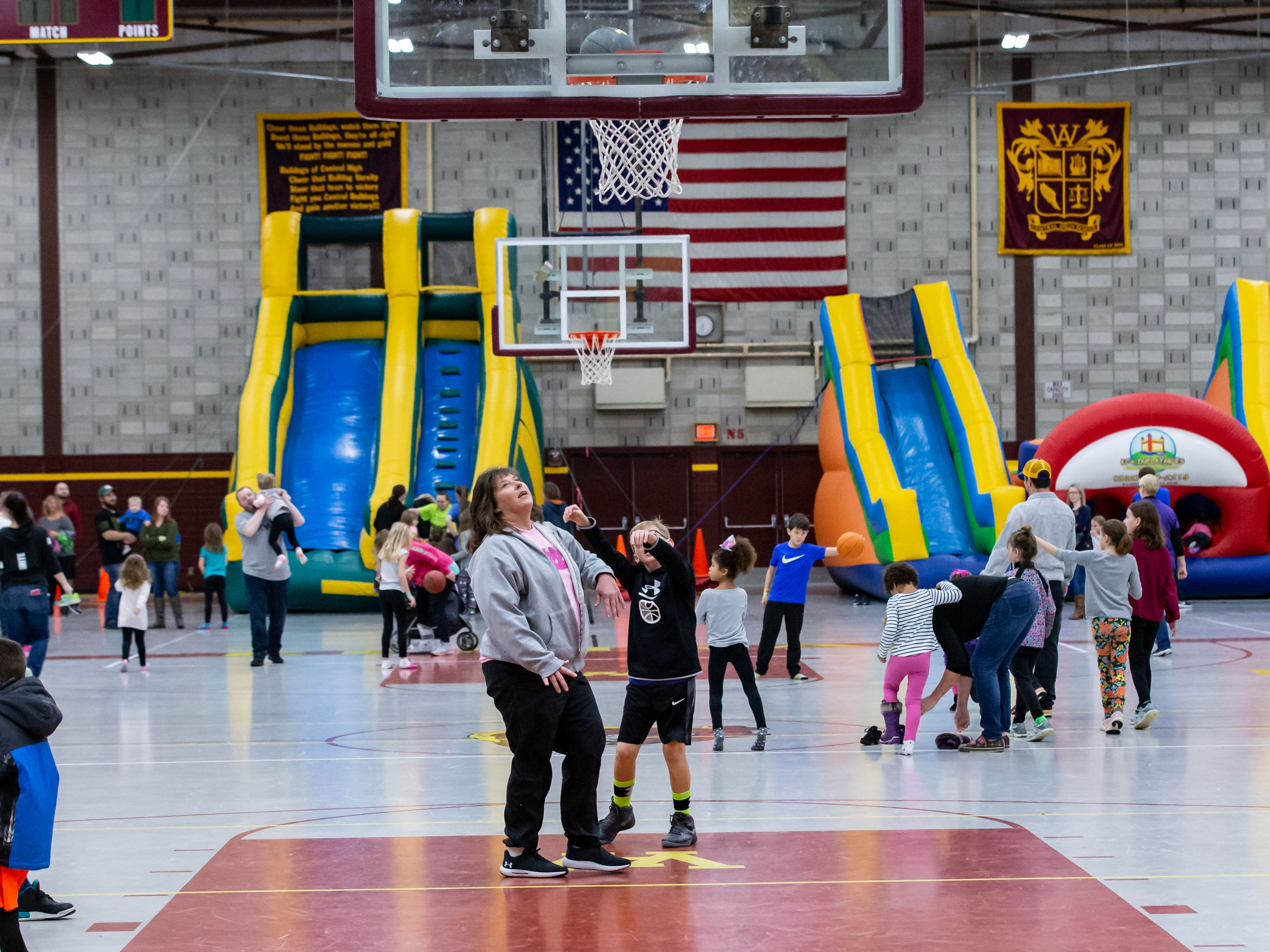 Families enjoy games, inflatables, music, swimming and more during the New Year's Eve Family Night at West Allis Central High School hosted by CAAD - West Allis (the West Allis-West Milwaukee Community Alliance Against Drugs) on Monday evening, Dec. 31, 2018.