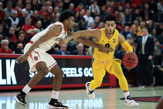 Markus Howard tries to drive past St. John's guard Justin Simon during the Golden Eagles' Big East opener Tuesday.