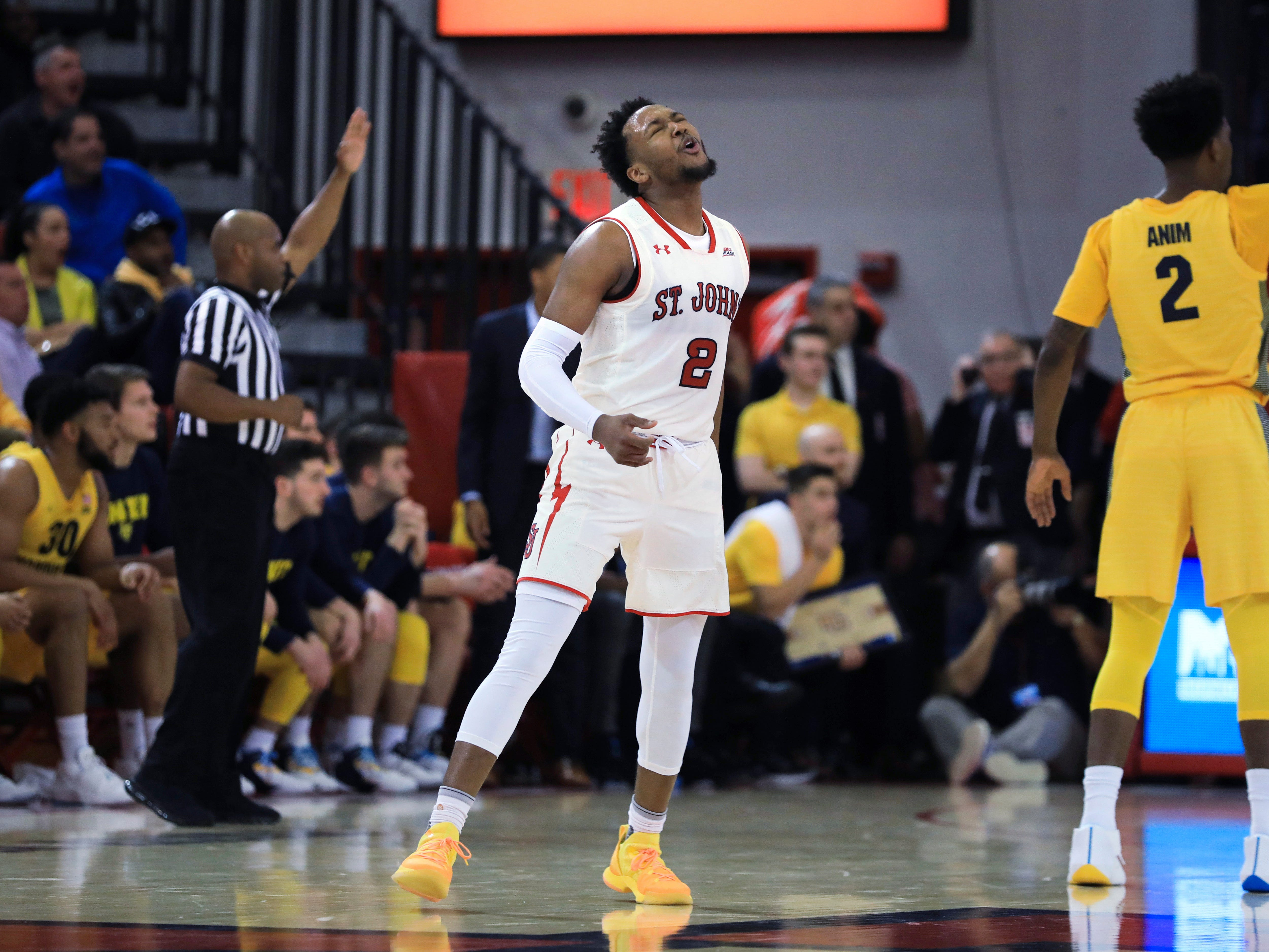 St. John's guard Shamorie Ponds winces after missing a shot during the first half of an NCAA college basketball game against Marquette on Tuesday, Jan. 1, 2019, in New York. (AP Photo/Kevin Hagen). ORG XMIT: NYKH107