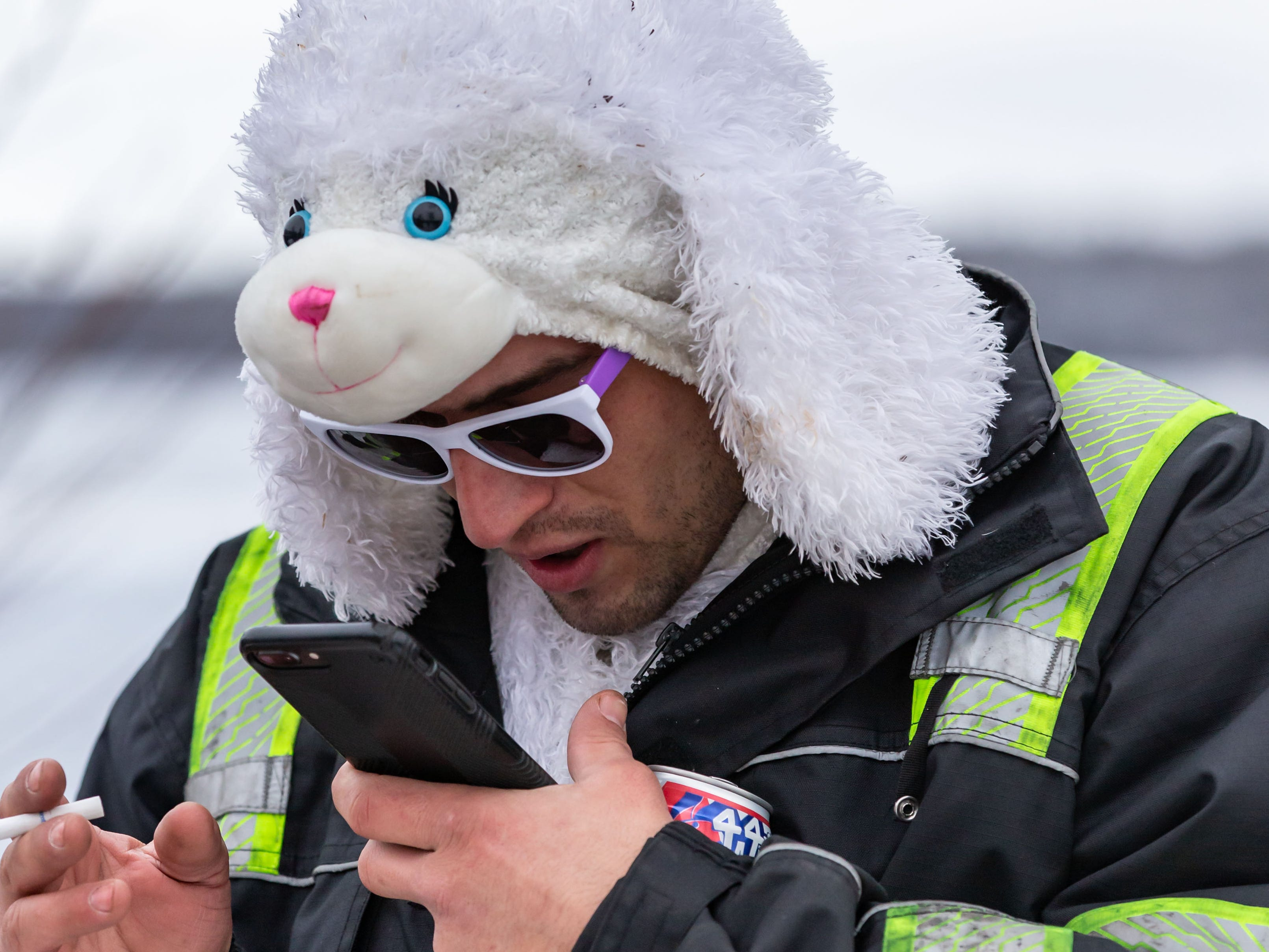 Tyler Bentley texts his next of kin prior to participating in the annual Polar Plunge at Panga Bar & Grill in Oconomowoc on Tuesday, Jan. 1, 2019. Funds raised from this year's plunge will benefit research efforts of the Alzheimer's Association.
