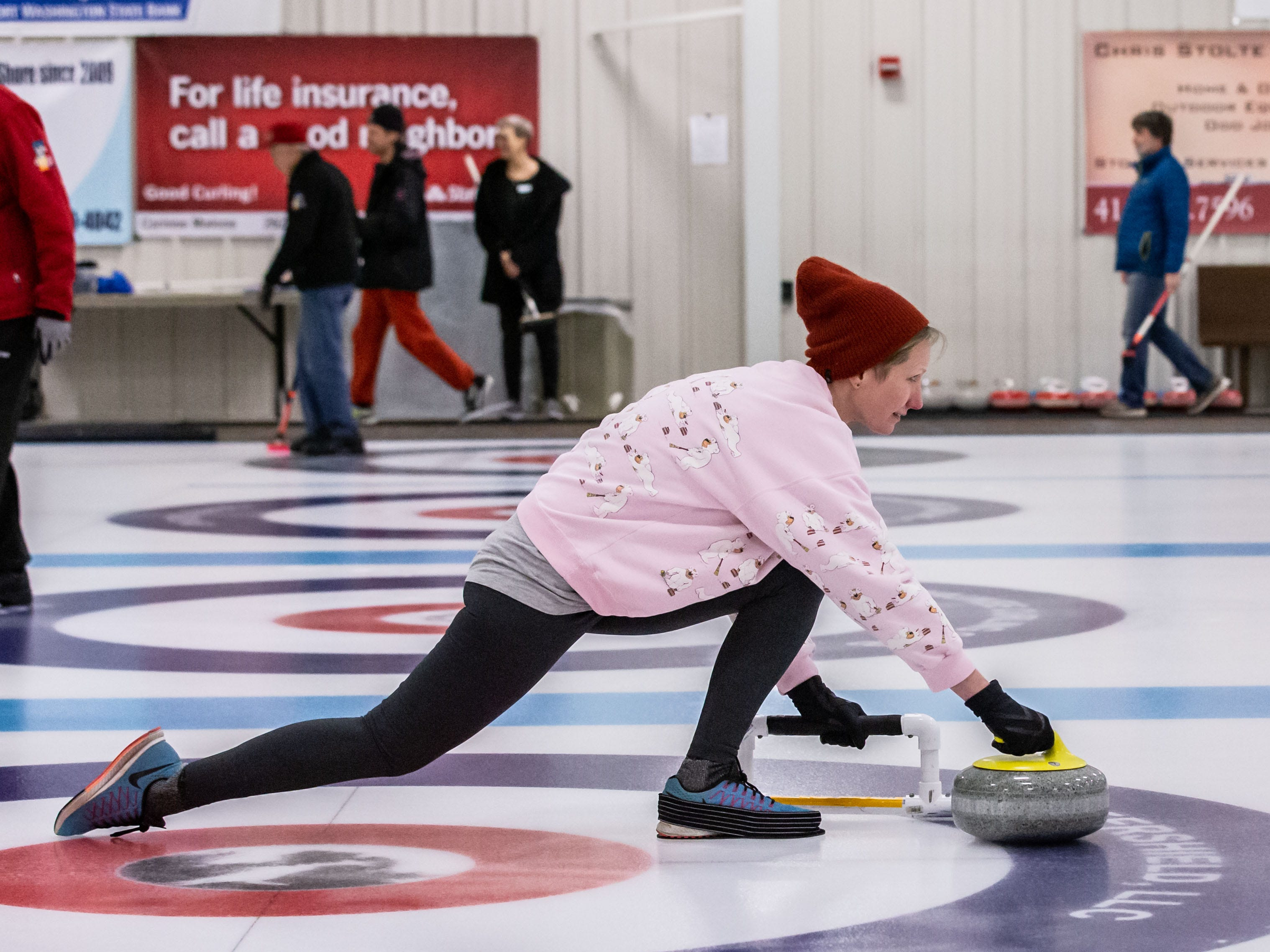 Ingrid Stromberg of San Diego practices releasing a stone during the Learn to Curl program at the Milwaukee Curling Club in Cedarburg on Saturday, Dec. 29, 2018.