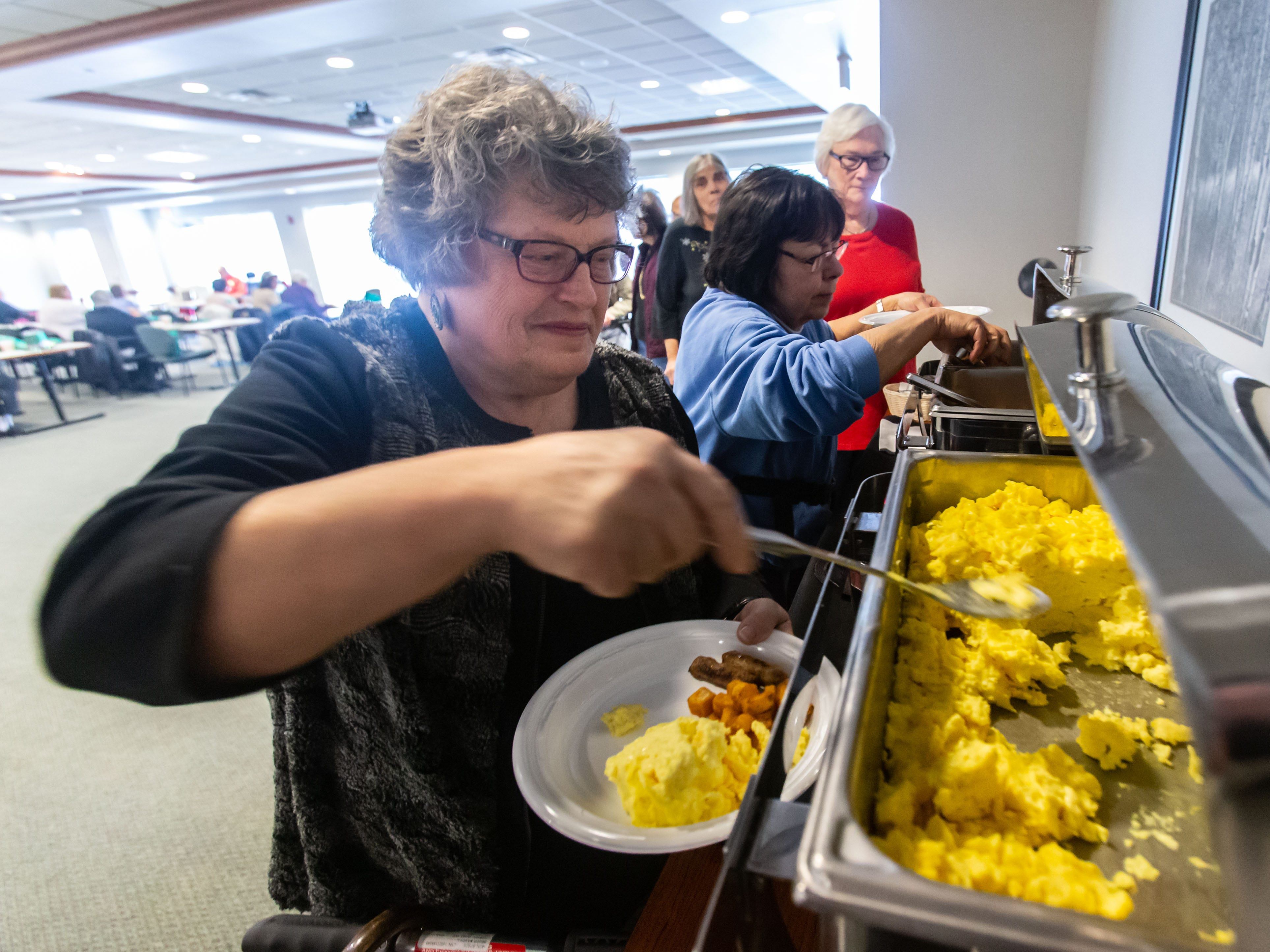 Nancy Beder of Waukesha fills a plate at the self-serve buffet during the free monthly senior breakfast club at Aurora Health Care in Summit on Tuesday, Jan. 1, 2019. Senior Breakfast Club is held from 8 to 10 a.m. on the first Tuesday of each month and is open to seniors and their families. For more info please call Trish Golden at 262-434-1248.