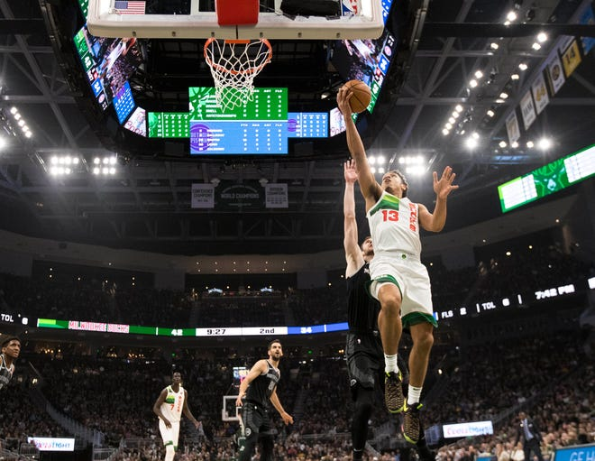 Jan 1, 2019; Milwaukee, WI, USA; Milwaukee Bucks guard Malcolm Brogdon (13) shoots during the second quarter against the Detroit Pistons.