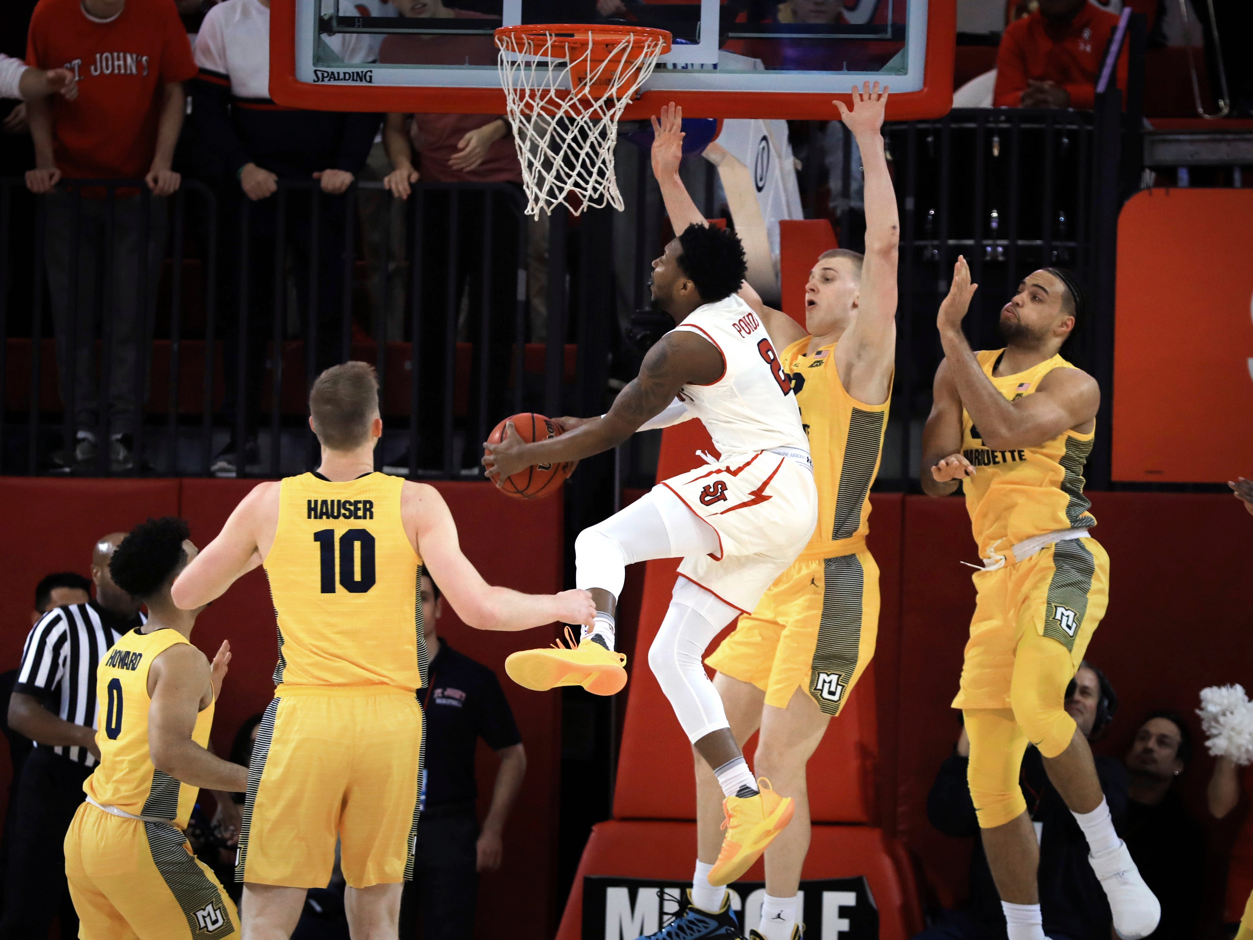 St. John's guard Shamorie Ponds goes up for a layup during the first half of an NCAA college basketball game against Marquette on Tuesday,  Jan. 1, 2019, in New York. (AP Photo/Kevin Hagen). ORG XMIT: NYKH102