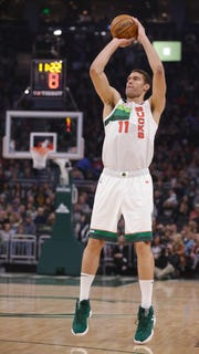 Milwaukee Bucks' Brook Lopez makes a 3-point basket against the Detroit Pistons during the first half of an NBA basketball game Tuesday, Jan. 1, 2019, in Milwaukee. (AP Photo/Jeffrey Phelps)