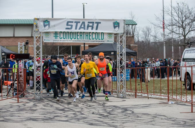 Runners burst off the starting line for the 10K race during the 14th annual Run Into the New Year hosted by Lighthouse Events at the Milwaukee County Sports Complex in Franklin on Monday, Dec. 31, 2018.