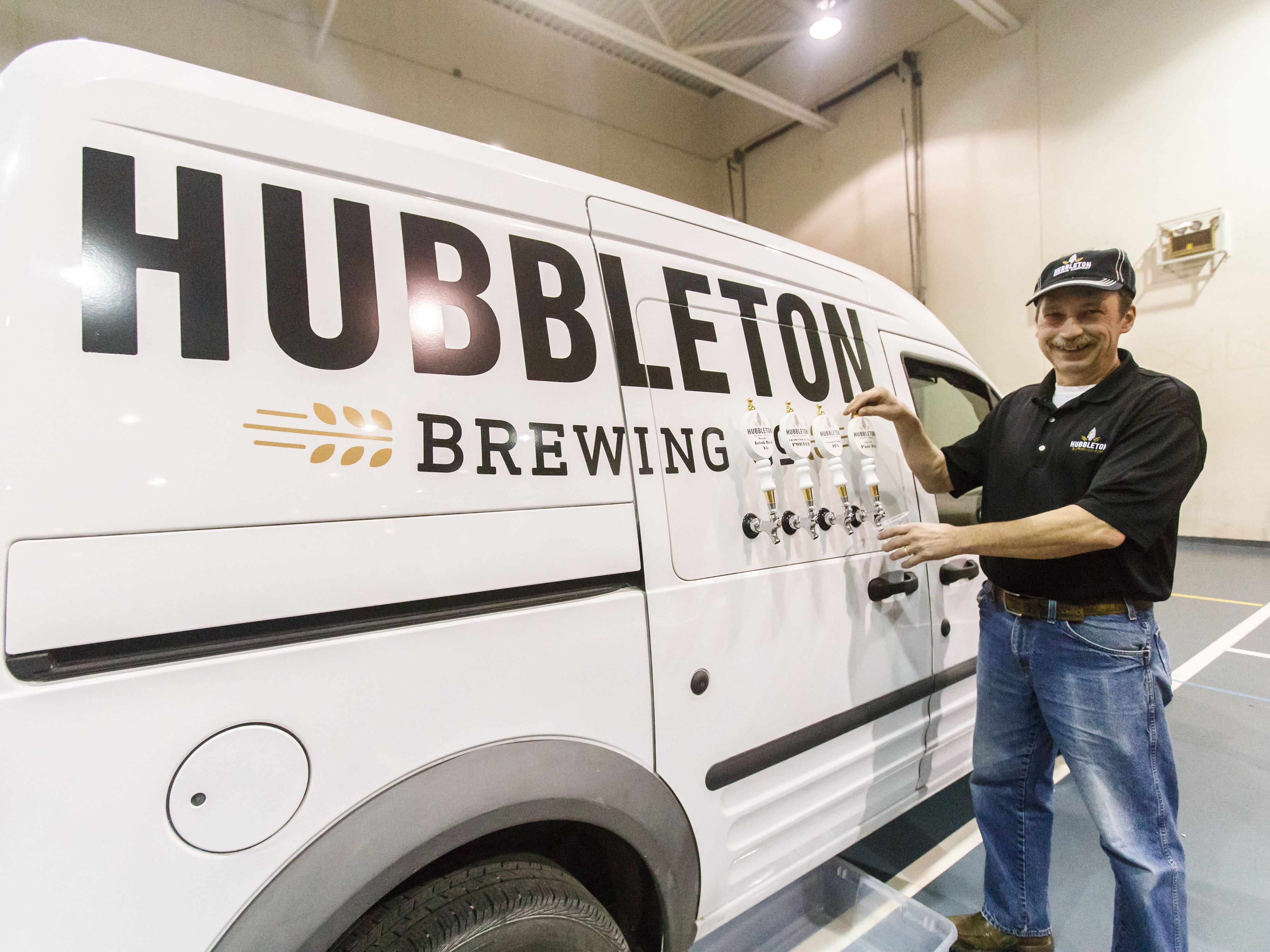 Owner Dan Schey of Hubbleton Brewing prepares for an onslaught of thirsty runners during the 14th annual Run Into the New Year hosted by Lighthouse Events at the Milwaukee County Sports Complex in Franklin on Monday, Dec. 31, 2018.
