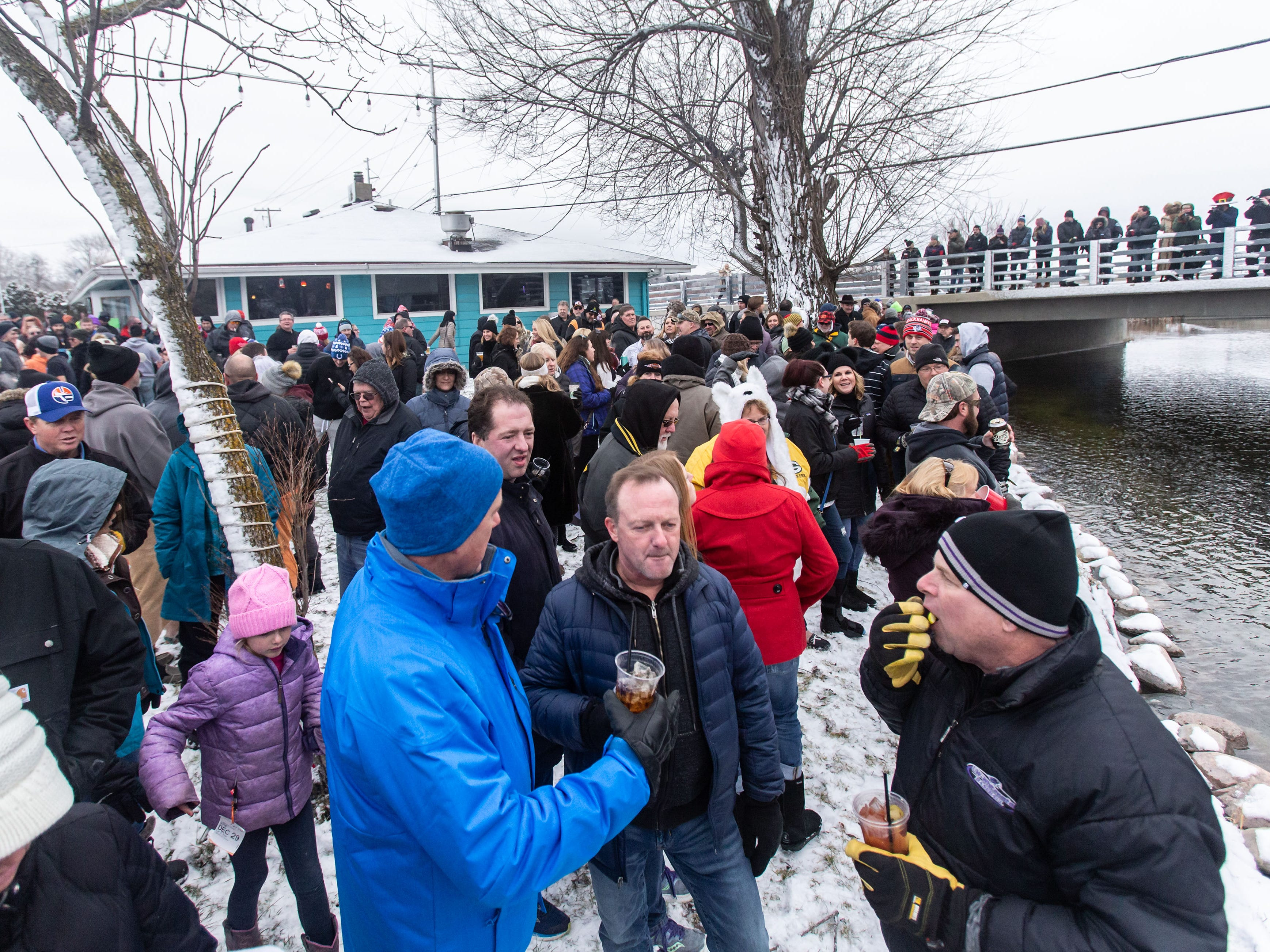 Hundreds of spectators gather to watch the annual Polar Plunge at Panga Bar & Grill in Oconomowoc on Tuesday, Jan. 1, 2019. Funds raised from this year's plunge will benefit research efforts of the Alzheimer's Association.