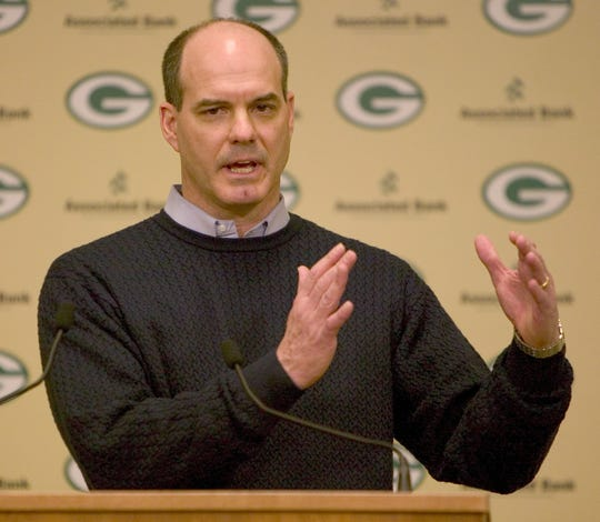 Ed Donatell talks to reporters about his dismissal by the Packers, Friday, Jan. 16, 2004, during a news conference in Green Bay.