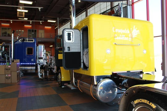 The Corn Patch Cadillac, a Peterbilt cab in canary yellow, is on display at Iowa 80, the world's largest truck stop.