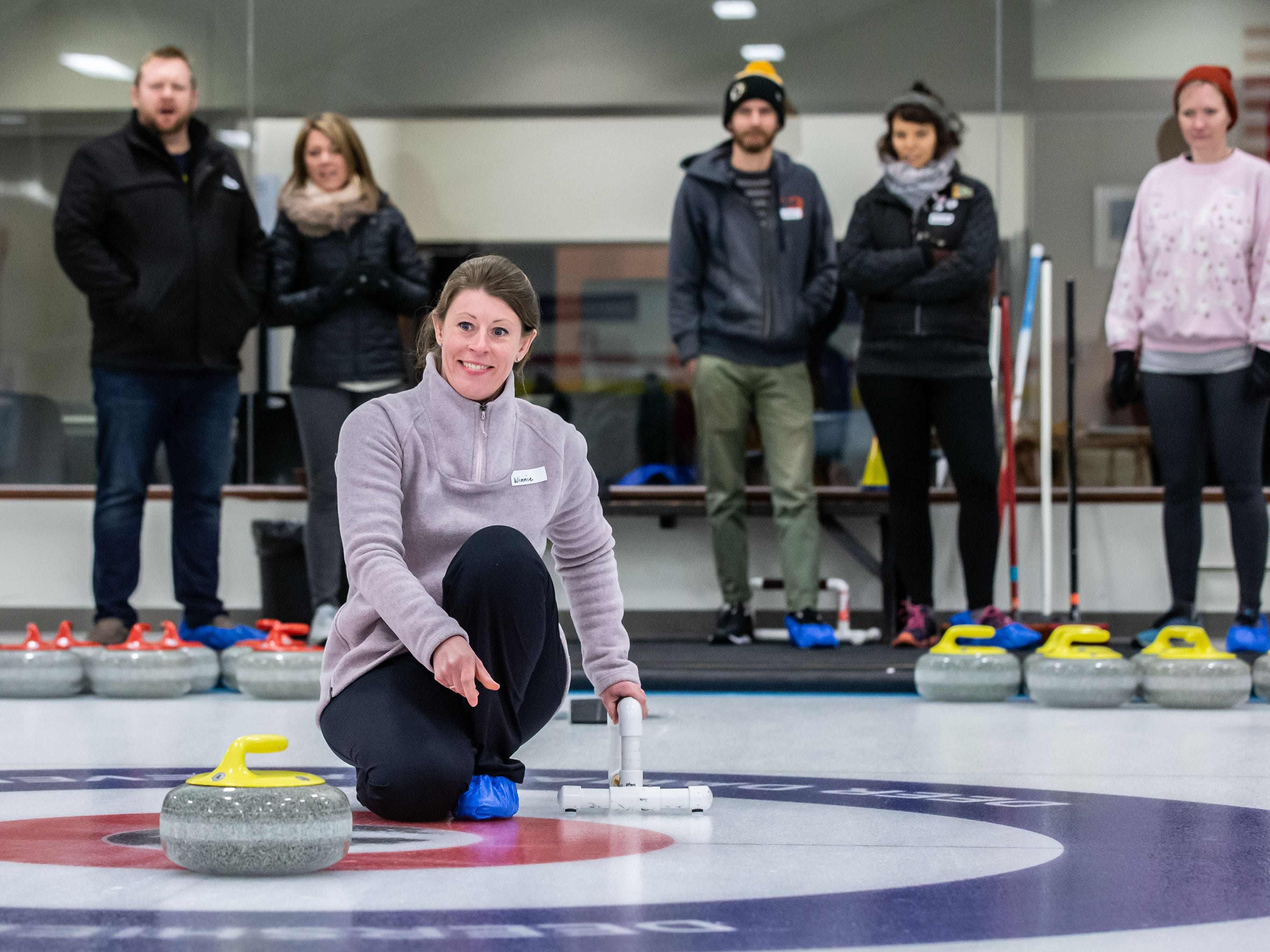 Winnie Sorensen of Mequon practices releasing a stone during the Learn to Curl program at the Milwaukee Curling Club in Cedarburg on Saturday, Dec. 29, 2018. The Milwaukee Curling Club was founded in 1845 and is the longest continually operating curling club in the United States.