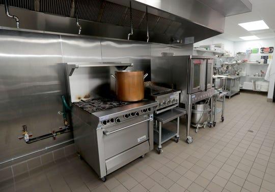 The kitchen area in the new La Merenda Market.