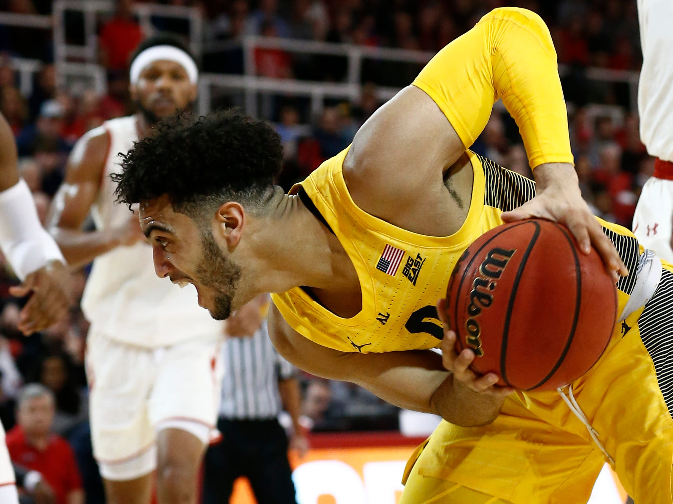 Marquette  guard Markus Howard controls the ball against St. John's guard Mustapha Heron in the first half.