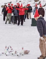 The crowd cheers a strike at the Turkey Bowling at a past year's Scandihoovian Winter Festival in Mt. Horeb, including festival organizer Jane Burns (in the light blue coat).