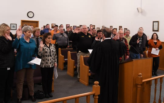Members of the Baxter County Sheriff's Office are sworn in Tuesday morning by Circuit Court Judge Andrew Bailey.