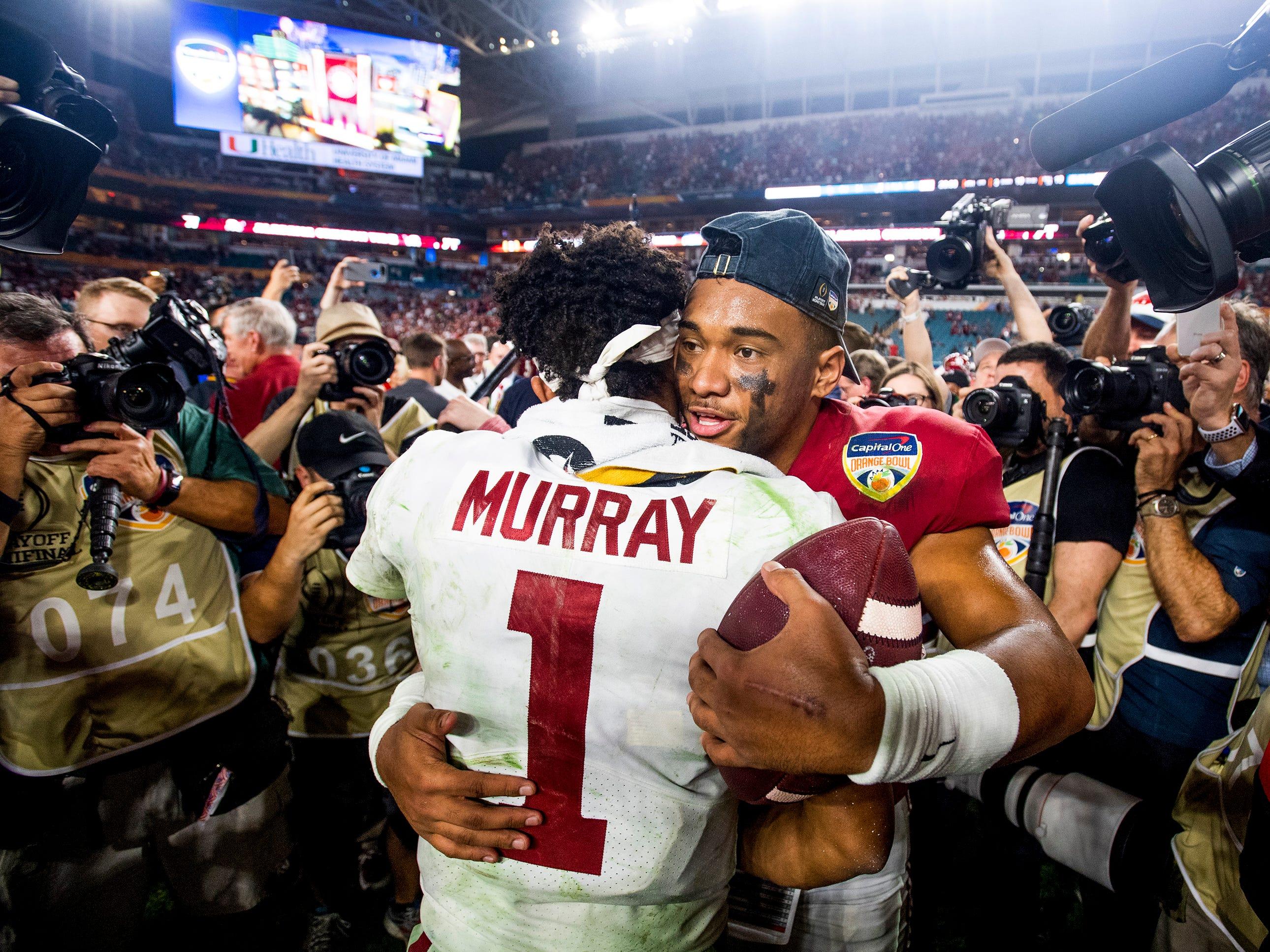 Alabama quarterback Tua Tagovailoa (13) hugs and talks with Oklahoma quarterback Kyler Murray (1) after the Orange Bowl at Hard Rock Stadium in Miami Gardens, Fla., on Saturday December 29, 2018.