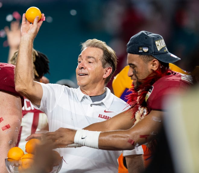 Alabama head coach Nick Saban throws oranges from the trophy after the Orange Bowl at Hard Rock Stadium in Miami Gardens, Fla., on Saturday December 29, 2018.
