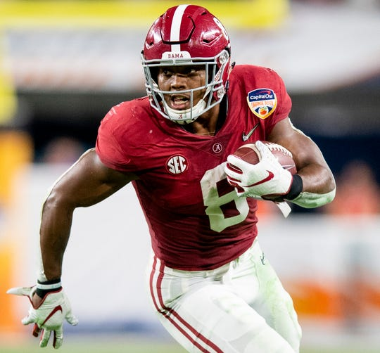 Alabama running back Josh Jacobs (8) carries the ball against Oklahoma in first half action of the Orange Bowl at Hard Rock Stadium in Miami Gardens, Fla., on Saturday December 29, 2018.