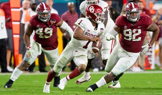 Oklahoma quarterback Kyler Murray (1)  is pressured by Alabama defensive linemen Isaiah Buggs (49) and  Quinnen Williams (92)in second half action of the Orange Bowl at Hard Rock Stadium in Miami Gardens, Fla., on Saturday December 29, 2018.